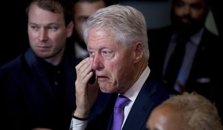 Former President Bill Clinton wipes his eye as his wife, Democratic presidential candidate Hillary Clinton greets staff and supporters after speaking at the New Yorker Hotel in New York, Wednesday, Nov. 9, 2016, where she conceded her defeat to Republican Donald Trump after the hard-fought presidential election. (AP Photo/Andrew Harnik)