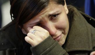 A woman cries as election results are announced during Democratic presidential nominee Hillary Clinton's election night rally in the Jacob Javits Center glass enclosed lobby in New York, Tuesday, Nov. 8, 2016. (AP Photo/David Goldman)