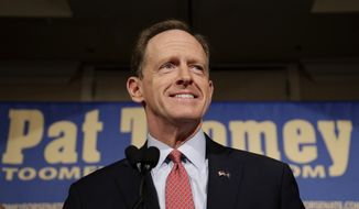 Sen. Pat Toomey, R-Pa., smiles as he speaks to supporters during an election night event, early Wednesday morning, Nov. 9, 2016, in Breinigsville, Pa. (AP Photo/Matt Slocum)