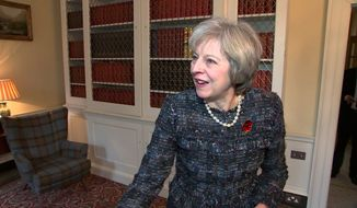 """In this image taken from video, British Prime Minister Theresa May comments on the election of Donald Trump as the next U.S. president, after his victory Wednesday, Nov. 9, 2016, in Downing Street, London. May congratulated Trump, saying the two countries will remain """"strong and close partners on trade, security and defense."""" (AP Photo/TV pool)"""