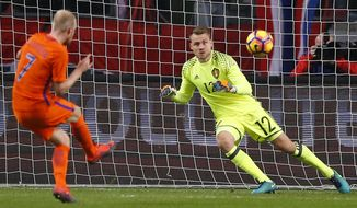 Netherlands' Davy Klaassen scores his side's first goal with a penalty as Belgium's goalkeeper Simon Mignolet dives to the wrong corner during the international friendly soccer match between Netherlands and Belgium at ArenA stadium in Amsterdam, Netherlands, Wednesday, Nov. 9, 2016. (AP Photo/Peter Dejong)