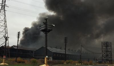 Smoke billows from the site ofa massive blaze at the former Bethlehem Steel Mill in Lackawanna, N.Y., on Wednesday, Nov. 9, 2016. The flames have since diminished, but smoke is visible for miles. No injuries were reported. (AP Photo/Carolyn Thompson)