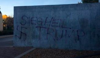Image of Trump graffiti discovered at the University of New Mexico the morning after the election on Nov. 9, 2016. Via the Albuquerque Journal [https://www.abqjournal.com/885573/anti-trump-graffiti-defaces-unm-sculpture-elsewhere-on-campus.html]