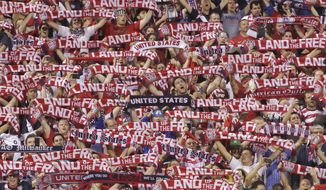FILE - In this Sept. 10, 2013, file photo, United States fans cheer on their team during the first half of a World Cup qualifying soccer match against Mexico in Columbus, Ohio. MAPFRE Stadium, home of the MLS Columbus Crew, is the site Friday night of the biggest international soccer game on American soil in three years: U.S. vs. Mexico in a qualifying match for the 2018 World Cup.  (AP Photo/Jay LaPrete, File)