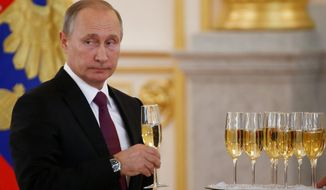 Champagne bottles were opened at the Kremlin on Wednesday as Russian President Vladimir Putin hosted a ceremony for foreign ambassadors. He said Moscow is ready to try to restore good relations with the U.S. in the wake of the election of Donald Trump. (Associated Press)