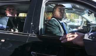 Donald Trump looks out from his car window in this Associated Press file photo.