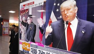 A TV screen shows pictures of U.S. President-elect Donald Trump, right, and North Korean leader Kim Jong Un, at the Seoul Railway Station in Seoul, South Korea, Thursday, Nov. 10, 2016. North Korea, which raced ahead with its nuclear and long-range missile development during the Obama administration, will almost certainly be one of the most challenging security issues the Trump White House faces in Asia. (AP Photo/Ahn Young-joon)