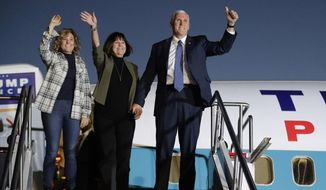 Vice President-elect Mike Pence with his wife, Karen, and daughter, Charlotte, acknowledge supporters as they get off a plane after arriving for a public rally Thursday, Nov. 10, 2016, in Indianapolis. (AP Photo/Darron Cummings)