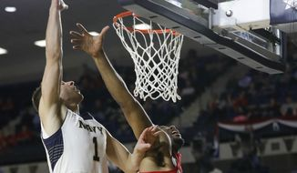 Navy forward Tom Lacey, left, shoots over Ohio State center Trevor Thompson, center, and forward Jae'Sean Tate in the second half of an NCAA college basketball game at the Veterans Classic tournament, Friday, Nov. 11, 2016, in Annapolis, Md. (AP Photo/Patrick Semansky) **FILE**