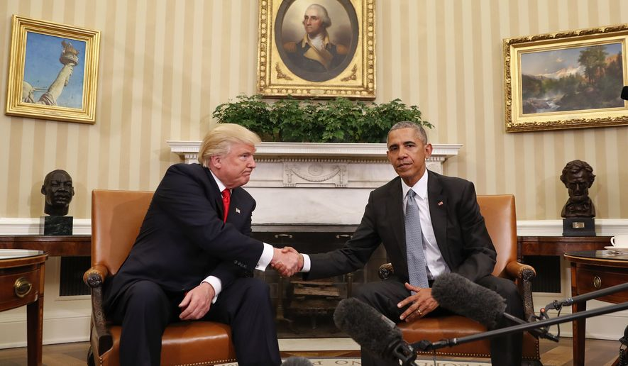 President Barack Obama and President-elect Donald Trump shake hands following their meeting in the Oval Office of the White House in Washington, Thursday, Nov. 10, 2016. (AP Photo/Pablo Martinez Monsivais) ** FILE **