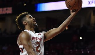 Maryland's Melo Trimble scores against American during the first half of an NCAA college basketball game, Nov. 11, 2016 in College Park, Md. (AP Photo/Gail Burton)
