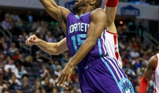 Charlotte Hornets guard Kemba Walker drives to the basket against the Toronto Raptors in the first half of an NBA basketball game in Charlotte, N.C., Friday, Nov. 11, 2016. (AP Photo/Nell Redmond)