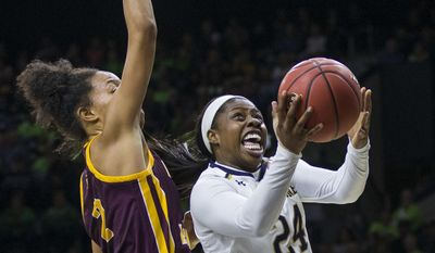 Notre Dame's Arike Ogunbowale (24) goes up for a shot next to Central Michigan's Tinara Moore (2) during the first half of an NCAA college basketball game Friday, Nov. 11, 2016, in South Bend, Ind. (AP Photo/Robert Franklin)