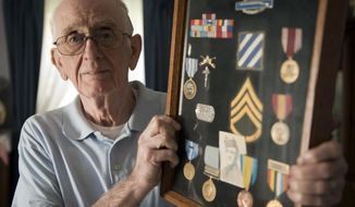 In this Oct. 1, 2016 photo, Don McIlrath, a Korean War veteran talks about his time at war, and his sight seeing trip back to Korea in 1998, at his home in Penn Hills, Pa. McIlrath joined the Army in 1951 when he was 18. (Dan Speicher/Tribune-Review via AP)