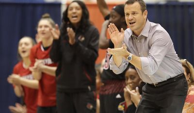 Louisville head coach Jeff Walz, right, applauds a score in the first half of an NCAA college basketball game against Tennessee-Martin Friday, Nov. 11, 2016, in Martin, Tenn. (AP Photo/Mark Humphrey)