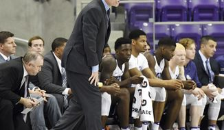 TCU head coach Jamie Dixon yells instructions to his players against St. Thomas during the first half of an NCAA college basketball game Friday, Nov. 11, 2016, in Fort Worth, Texas. (Bob Haynes/Star-Telegram via AP)