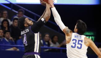 Kentucky's Derek Willis (35) blocks the shot of Stephen F. Austin's Ty Charles during the first half of an NCAA college basketball game, Friday, Nov. 11, 2016, in Lexington, Ky. (AP Photo/James Crisp)