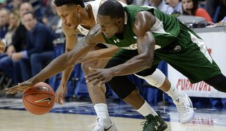 Connecticut's Jalen Adams, left, and Wagner's Michael Carey drive for a loose ball during the first half of an NCAA college basketball game, Friday, Nov. 11, 2016, in Storrs, Conn. (AP Photo/Jessica Hill)