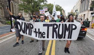 Anti-Trump protesters start their hike from Hemming Park to their announced destination at the offices of The Florida Times-Union newspaper, Saturday, Nov. 12, 2016, in Jacksonville, Fla. More than a hundred protesters gathered for a rally against President elect, Donald Trump, winning the presidential election in downtown Jacksonville. Tens of thousands of people marched in streets across the United States on Saturday, staging the fourth day of protests of Trump's surprise victory as president. (Bob Self/The Florida Times-Union via AP)