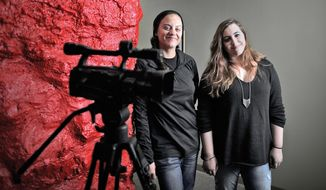 This Oct. 19, 2016 photo shows Brittany Bailey, left, and Emily Gage, both of Janesville, Wis.'s Videogenics, who are finishing a film about the Manteno psychiatric hospital that was started by their father John Gage before he died in 2008. (Anthony Wahl/The Janesville Gazette via AP)