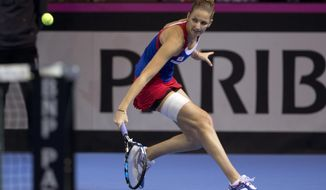 Czech Republic's Karolina Pliskova returns the ball to France's Kristina Mladenovic during the Fed Cup final in Strasbourg, eastern France, Saturday, Nov. 12, 2016. (AP Photo/Jean-Francois Badias)