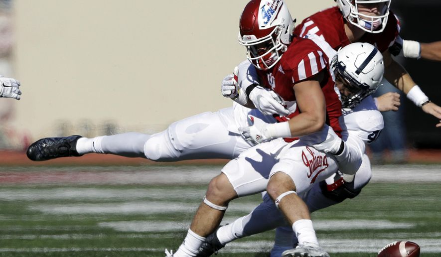 Indiana S Mitchell Paige Fumbles After Being Hit By Penn