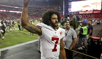 San Francisco 49ers quarterback Colin Kaepernick (7) makes a fist as he is booed by fans after an NFL football game against the Arizona Cardinals, Sunday, Nov. 13, 2016, in Glendale, Ariz. The Cardinals won 23-20. (AP Photo/Ross D. Franklin)