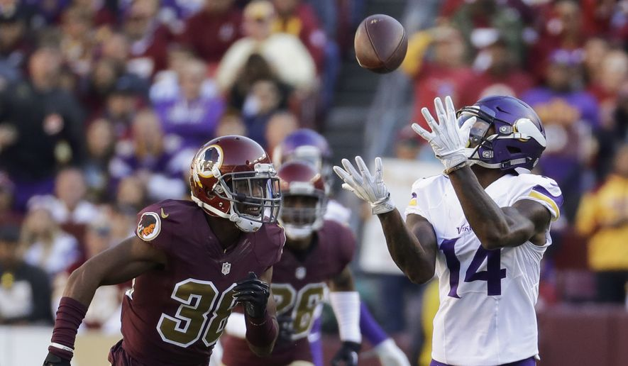 Minnesota Vikings wide receiver Stefon Diggs (14) pulls in a pass under pressure from Washington Redskins cornerback Kendall Fuller (38) during the first half of an NFL football game in Landover, Md., Sunday, Nov. 13, 2016. (AP Photo/Patrick Semansky)