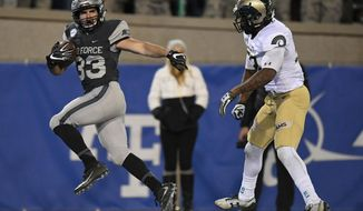 Air Force running back Tim McVey gets into the end zone past Colorado State linebacker Tre Thomas on a touchdown during the second quarter of an NCAA college football game in Colorado Springs, Colo., Saturday, Nov. 12, 2016. (Mark Reis/The Gazette via AP)