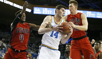 UCLA forward Gyorgy Goloman, center, grabs a rebound between Cal State Northridge forward Tavrion Dawson, left, and center Dylan Johns during the second half of an NCAA college basketball game Sunday, Nov. 13, 2016, in Los Angeles. UCLA won 102-87. (AP Photo/Danny Moloshok)