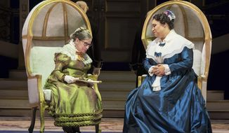"""This Thursday, Nov. 10, 2016 photo released by the Washington National Opera shows U.S. Supreme Court Justice Ruth Bader Ginsburg, left, as the Duchess of Krakenthorp in a dress rehearsal of Donizetti's """"The Daughter of the Regiment"""" at the Washington National Opera, in Washington. Seated next to her is Deborah Nansteel as the Marquise of Berkenfield. The performance marks Ginsburg's debut in an operatic speaking role.  (Scott Suchman/WNO via AP)"""