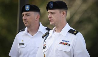 FILE - In a July 7, 2016 file photo, Sgt. Bowe Bergdahl, right, arrives with his military lawyer, Lt. Col. Franklin Rosenblatt, for a legal hearing at the courtroom facility, on Fort Bragg, N.C.  A military judge is delaying the trial of Bergdahl on charges of desertion and misbehavior before the enemy. Army Col. Jeffery Nance decided to push the trial back to May 2017 during a pretrial hearing Monday, Nov. 14, at Fort Bragg in North Carolina. The trial had been scheduled for February. (Andrew Craft/The Fayetteville Observer via AP, File)