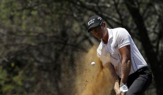Henrik Stenson of Sweden blast out of bunker on the six green during the Nedbank Golf Challenge in Sun City, South Africa,Sunday, Nov. 13, 2016. (AP Photo/Themba Hadebe)