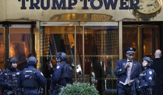 Members of the New York Police Department's counterterrorism unit guard Trump Tower, Monday, Nov. 14, 2016. (AP Photo/Mark Lennihan)