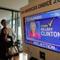 A long night: TV watchers examine early predictions on election night. A recent poll found 27 percent of Americans are avoiding the news. (Associated Press)
