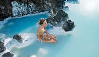Solo simmering in the soothing Blue Lagoon near Reykjavik in Iceland. (Photo courtesy of Blue Lagoon)
