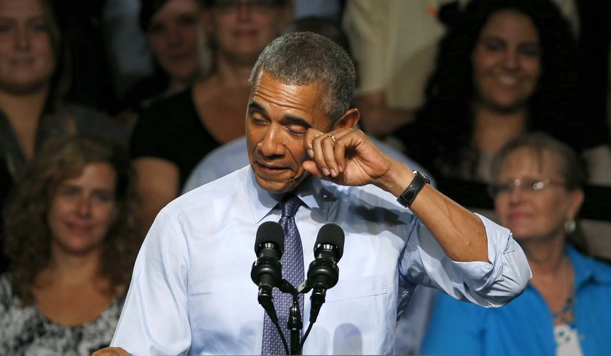 """President Barack Obama pretends to wipe a tear during his speech at Macomb County Community College Wednesday, Sept. 9, 2015, in Warren, Mich. The president said he's """"a little freaked out"""" that his oldest daughter, Malia, just started her senior year in high school. (AP Photo/Paul Sancya)"""