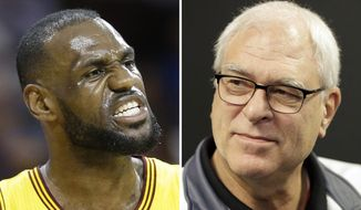 Cleveland Cavaliers forward LeBron James reacts during the first half of Game 5 in a second-round NBA basketball playoff series against the Chicago Bulls, in Cleveland, May 12, 2015. At right, in a Feb. 8, 2016, file photo, New York Knicks president Phil Jackson speaks to reporters during a news conference in Greenburgh, N.Y. LeBron James says he has lost respect for Phil Jackson after the famed NBA coach used the word posse to describe the Cleveland stars business partners. James responded harshly on Tuesday, Nov. 15, 2016, to Jacksons use of the term in a recent interview. (AP Photo/File)