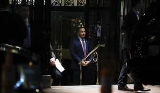 Security personnel stand at entrance of 21 Club Restaurant, Tuesday, Nov. 15, 2016, in New York, where President-elect Donald Trump is having dinner. (AP Photo/Carolyn Kaster)