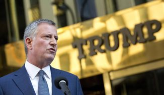 "New York Mayor Bill de Blasio holds a news conference in front of Trump Tower following a meeting with President-elect Donald Trump, Wednesday, Nov. 16, 2016, in New York. De Blasio said that Trump ""loves this city"" and added that he urged the Republican president-elect to send a ""sign of unity"" to his hometown, which overwhelmingly voted for Democrat Hillary Clinton. (AP Photo/Mark Lennihan)"