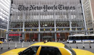 In this Oct. 18, 2011, file photo, traffic passes the New York Times building, in New York. (AP Photo/Mark Lennihan, File)