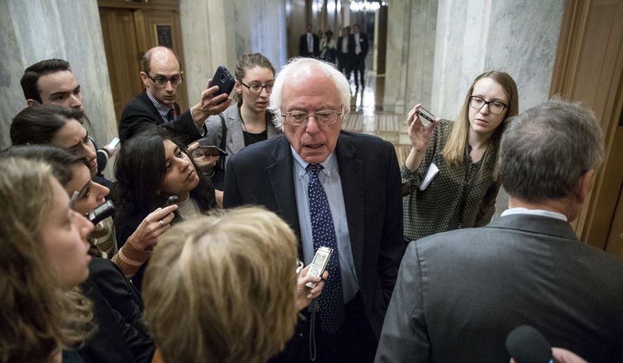 In this Nov. 16, 2016 file photo, Sen. Bernie Sanders, I-Vt. speaks to reporters on Capitol Hill in Washington. Sanders is calling on Donald Trump to apologize for some of his controversial rhetoric during the presidential campaign and asking him cut ties with campaign CEO Steve Bannon.  (AP Photo/Andrew Harnik, File) **FILE**