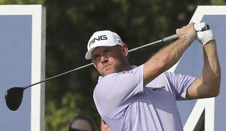 Lee Westwood of England tees off on the 14th hole during the 1st round of the DP World Tour Championship golf tournament at the Jumeirah Golf Estates in Dubai, United Arab Emirates, Thursday, Nov. 17, 2016. (AP Photo/Kamran Jebreili)