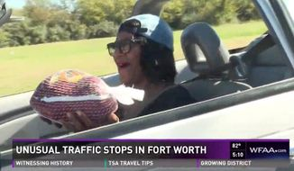 Police officers in Fort Worth, Texas, surprised drivers this week by handing out turkeys instead of tickets in the spirit of Thanksgiving. (WFAA)