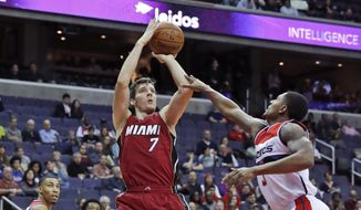Miami Heat guard Goran Dragic (7), from Slovenia, shoots over Washington Wizards guard Bradley Beal (3) during the first half of an NBA basketball game Saturday, Nov. 19, 2016, in Washington. The Heat won 114-111. (AP Photo/Alex Brandon)