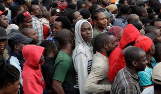 Haitians line up at an immigration agency in Tijuana, Mexico, with the hope of crossing to the U.S. side of the border. U.S. Customs and Border Protection can handle only up to about 75 people a day at the San Ysidro port of entry. (Associated Press)