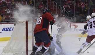 Columbus Blue Jackets goalie Sergei Bobrovsky (72), of Russia, defends the net in front of Washington Capitals forward Paul Carey (28) and Columbus Blue Jackets defenseman Markus Nutivaara (65), of Finland during second period of their NHL hockey game, Sunday, Nov. 20, 2016, in Washington. Blue Jackets defeated the Capitals 3-2. (AP Photo/Molly Riley)