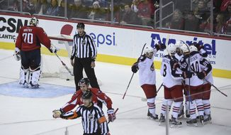 Washington Capitals goalie Braden Holtby (70) stands in the net after Columbus Blue Jackets center Alexander Wennberg (10), of Sweden, scored a goal during third period of their NHL hockey game, Sunday, Nov. 20, 2016, in Washington. Blue Jackets defeated the Capitals 3-2. (AP Photo/Molly Riley)