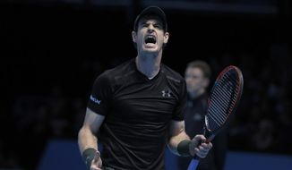 Andy Murray of Britain shouts after winning the ATP World Tour Finals singles final tennis match against Novak Djokovic of Serbia at the O2 Arena in London, Sunday, Nov. 20, 2016. (AP Photo/Kirsty Wigglesworth)