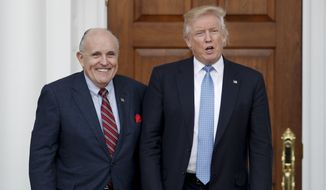 President-elect Donald Trump, right, and former New York Mayor Rudy Giuliani pose for photographs as Giuliani arrives at the Trump National Golf Club Bedminster clubhouse, Sunday, Nov. 20, 2016, in Bedminster, N.J.. (AP Photo/Carolyn Kaster) ** FILE **
